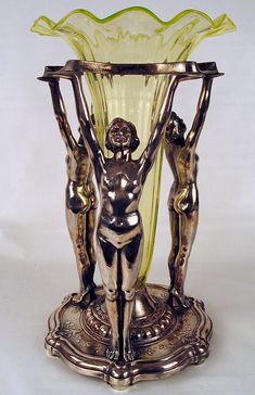 Fabulous Art Deco silver plated flower vase with 3 women supporting a vaseline glass insert. c1928.