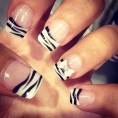 Zebra tips with rhinestone bow on accent nail