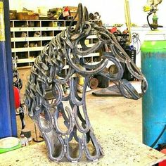 So cool, horse made out of horseshoes!