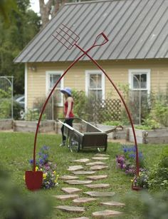 Oversize garden tools form a big, bold arch for a fanciful landscape accent. At 9' high, this is a unique piece of art that proclaims your passion for gardening!