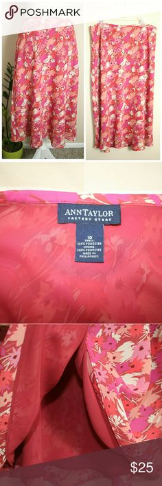 """Ann Taylor Floral A-Line Midi Skirt Size 10 New without tags and never worn. Beautiful A-Line Floral Print Skirt from Ann Taylor Factory Store. Size 10. Midi Length. Pink, purple, and peach color. With full lining and side zipper. Flowy and delicate type of fabric. Exterior and lining 100% polyester.   ℹ Lower waist about 30""""-32"""" (measured flat) ℹ Length about 27"""" Ann Taylor Factory Skirts Midi"""