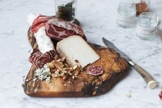 herriott grace charcuterie board in dark maple, makes for a great base for a rustic cheese and charcuterie board