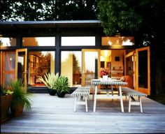 I will never forget Domino's tour of Carina Schott (nonchalantmom.com)'s home.  Since then, I've dreamt of a back porch like this one.