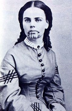 "Olive Ann Oatman Fairchild - captive by Indians in Arizona. She and her younger sister were captured when their family was killed.  Her older brother survived..tatoo markings are seen in the AMC movie channel series ""Hell on Wheels"" the story of the railroad."