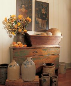 stoneware crocks, chest (love the paint) and the wooden bowls in the dough box