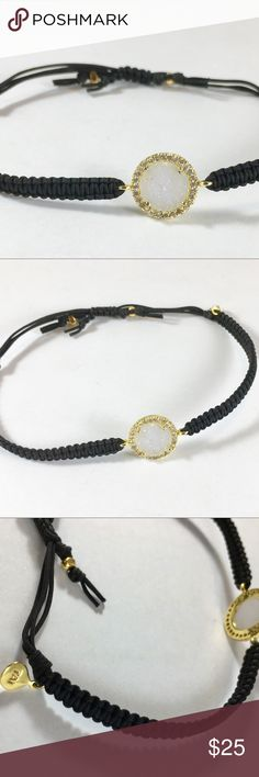 Beautiful TAI corded druzy bracelet Beautiful TAI corded druzy bracelet. Black Silk and Nylon braided together create the adjustable band and the gorgeous center white drruzy stone is set in 18k gold. Never worn, like new. Price is firm TAI Jewelry Bracelets