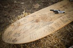 Skate deck or a surf board guest book would work so well with a beach wedding.