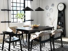 Bright white wall paint ideas for a dining room with black furniture