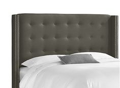 Fashion and function combine with the Cranford king headboard. It features trendy linen upholstery with gleaming nail head trim along the silhouette. Its unique design will make this headboard the centerpiece of your room.