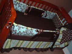 Blue & Brown Set   Included in this custom baby crib bedding set is the bumper pad, soft minky backed blanket, and tailored stripe crib skirt polka dot border.  Includes all designer decorator cotton fabrics in coordinating polka dots, stripe, and damask and super soft chocolate minky.