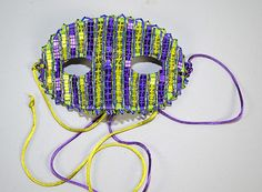 BEAD EMBROIDERY PURPLE AND GREEN MASK = Purple an - by Dargate Auction Galleries
