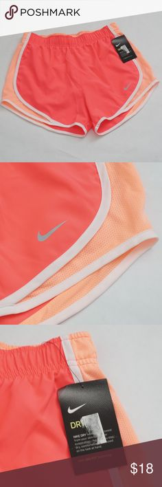 Nike Dry Tempo Dri-Fit Women Run Shorts in Orange Dri-Fit Technology Neon Orange with soft orange trims Nike Dry fabrics move sweat from your skin for quicker evaporation Elastic with drawstring waist Help stay dry and comfortable Underwear liner Exclusive of decoration Body: 100% Recycled Polyester Made in Vietnam Retail Price: $30 Nike Shorts
