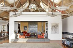 The living area of Zara Chancellor and Charles McIntyre's Suffolk, England, home, a former dairy barn converted by the architectural firm Woollacott Gilmartin.