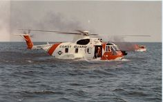 HH-3F-Pelican. A Coast Guard HH-3F Pelican demonstrates its amphibious capability while rescuing a boater who has abandoned his burning vessel. U.S. Coast Guard photo