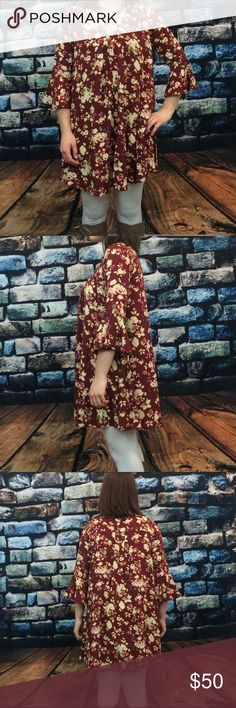 """Floral Print A Line Tunic Wine colored floral print a line tunic with ¾ sleeves with a ruffled bottom. Features strappy neckline. Model is 5'6"""" wearing a size S. Tops Tunics"""