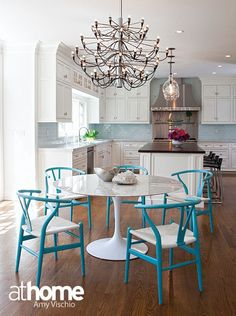 Turquoise wishbone chairs heat up this dining room