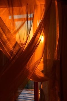 I liked this photo because we are seeing the light through a translucent sheet which distributes the light beautifully, but it also allows us to see the intensity that permits the light to shine through the sheet. Orange Aesthetic, Rainbow Aesthetic, Aesthetic Colors, Aesthetic Vintage, Aesthetic Photo, Aesthetic Pictures, Murs Oranges, Orange Tapete, Picture Wall