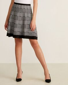 Shop at Century 21 for shoes, clothing, jewelry, dresses, coats and more from top brands with trendy styles. Houndstooth Skirt, Fit And Flare Skirt, Female Models, Trendy Fashion, Tweed, Elastic Waist, Black And White, Knitting, Lady