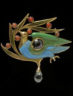 A Victorian gold, enamel garnet and coral brooch 'The Blue Bird' made by Carlo…