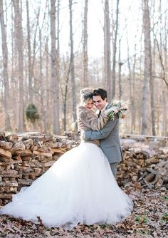 How sweet is this winter wedding bride and groom?