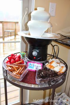"""Frozen Party Food - """"Elsa's Endless Winter"""" - white chocolate fountain with an assortment of items for dipping"""