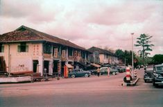 Junction of Jalan Jurong Kechil with Upper Bukit Timah Road. The Bukit Timah Market is between the two rows of shophouses.  1968-70