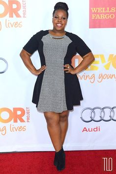 Amber Riley looks perfect in a chic dress and booties- a great look for work or play!