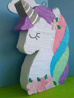 UNICORN PINATA. Measures 24 inches tall, 17 inches wide, 4 inches deep. Colors for the Unicorn can be change to match your party colors. Just contact me for any aditional help you might need. If you cant find the character or design you are looking for your party, do not worry, I will be
