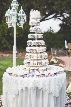 Cupcake Tower w/ Specialty Linens - http://www.StyleMePretty.com/california-weddings/2014/03/29/vintage-whimsical-wedding-at-fullerton-arboretum/ Koman Photography - komanphotographyblog.com/ on #SMP