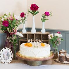 """The cake topper spelled out """"Milele,"""" which means """"forever"""" in Swahili."""