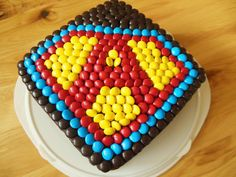Superman cake...make this SuperGIRL with Skittles in pink, purple and orange