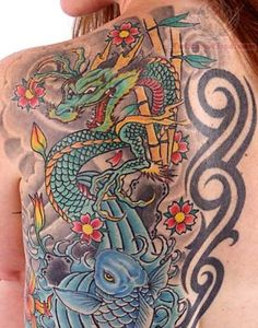 Beautiful japanese tattoo, including a dragon, a koi fish, cherry blossoms, and bamboo trees. Dragon Tattoo Meaning, Dragon Tattoo Back, Dragon Tattoo For Women, Dragon Tattoo Designs, Back Tattoo, Tattoos For Women, Dragon Tattoo Pictures, Picture Tattoos, Traditional Japanese Dragon