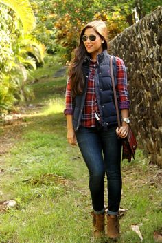 Shop this look on Lookastic: http://lookastic.com/women/looks/sunglasses-vest-watch-crossbody-bag-ankle-boots-dress-shirt-skinny-jeans/7585 — Black Sunglasses — Navy Quilted Vest — Silver Watch — Red Plaid Leather Crossbody Bag — Brown Suede Ankle Boots — Red Plaid Dress Shirt — Navy Skinny Jeans