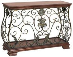 Antique Ironwork and Wood Console Table by Universal Lighting and Decor. $399.99. This elegant console table features a highly detailed iron body with scrolls, leaves and flower medallions. The ironwork comes in a beautiful antique finish. The wooden base and tabletop are gorgeously beveled. A wonderful piece for entryways, seating areas and more.