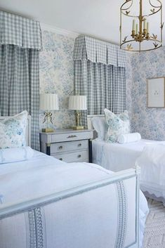 From the elegantly clad twin beds to the genius pattern mixing to the gilded ribbon lamps, we adore every detail of this bedroom in our favorite color scheme of blue and white! What colors bring joy and inspiration to your interiors? Photo: Nicola Bathie McLaughlin Guest Bedrooms, Girls Bedroom, Bedroom Decor, Guest Room, Bedroom Ideas, Dream Bedroom, Nursery Ideas, Bedroom Furniture, Style Me Pretty Living