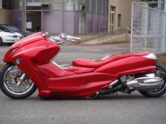 Akira. Yamaha Majesty. you gotta google what they look like before they are customized. trippy mods.