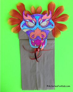 Chinese Dragon Puppet with dragon template to color and decorate.  Add this to a brown paper bag for a Chinese New Year Craft for kids from Activities for Kids