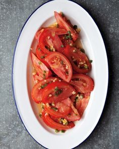 Tomatoes with Ginger, Lemon, and Chile | Minced ginger, lemon zest, and fresh jalapeno or serrano chile add an exciting bite to the standard tomato salad. Pair this easy side dish with grilled tuna, mahi mahi, or steak.