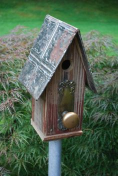 Hey, I found this really awesome Etsy listing at http://www.etsy.com/listing/157008700/antique-solid-brass-door-knob-birdhouse