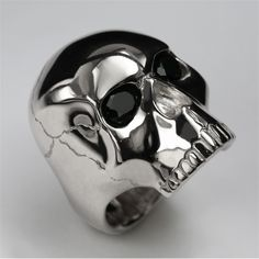 Designer Einhorn's Skull ring is one of his hero pieces, a statement design with a rock 'n' roll spirit. Each ring is handmade in our London workshops using solid precious metal, you won't find any plating here! You can keep the ring plain or have two 5mm round brilliant cut stones set into the eyes - peridot, black sapphires? The choice is all yours! Wear this ring if you are up for a Mercury or Ivor Novello award. What, you've already been? You didn't invite The Horn...