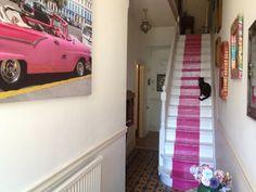 Black cat pink stairs