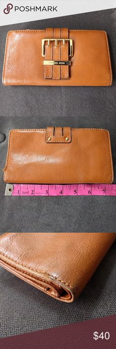 Michael Kors tan leather clutch wallet Used item, shows wear two corners and some spots. The ID pocket has weird yellow stain. Overall has lots of life left, from a smoke and pet-free home. Please look at all photos. Michael Kors Bags Wallets