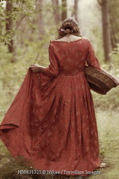 Trevillion Images - historical-woman-with-basket-outdoors