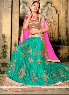 Everyone will admire you when you wear this clad to elegant affairs. Make the heads flip the moment you costume up in this stunning sea green net a line lehenga choli. The attractive embroidered and p...