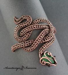 snake wire wrapping bracelet (reminds me of Valek's snake bracelet for Yelena)