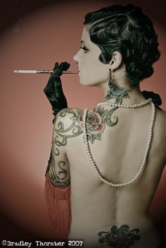 pearls gloves and cigarette holder