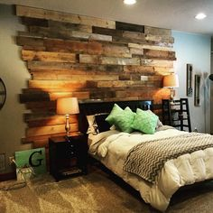 This beautiful bedroom features a wood wall of random barn wood planks. Add an accent wall to your bedroom to get just enough rustic character to feel comfy and cozy. This look works for any style and Feature Wall Bedroom, Accent Wall Bedroom, Bedroom Decor, Accent Walls, Bedroom Ideas, Rustic Bedroom Design, Bedroom With Wood Wall, Plank Wall Bedroom, Pallet Wall Bedroom