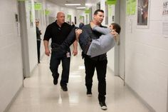 Daddy Direction being carried by the Den mother. <3