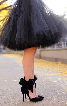 Black dress, black shoes with ribbon bow