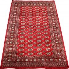 This is such a beautiful handmade oriental rug.The geometric pattern in this red area rug will add colorful warmth and comfort to any large room. This floor covering is great for a medium size room.